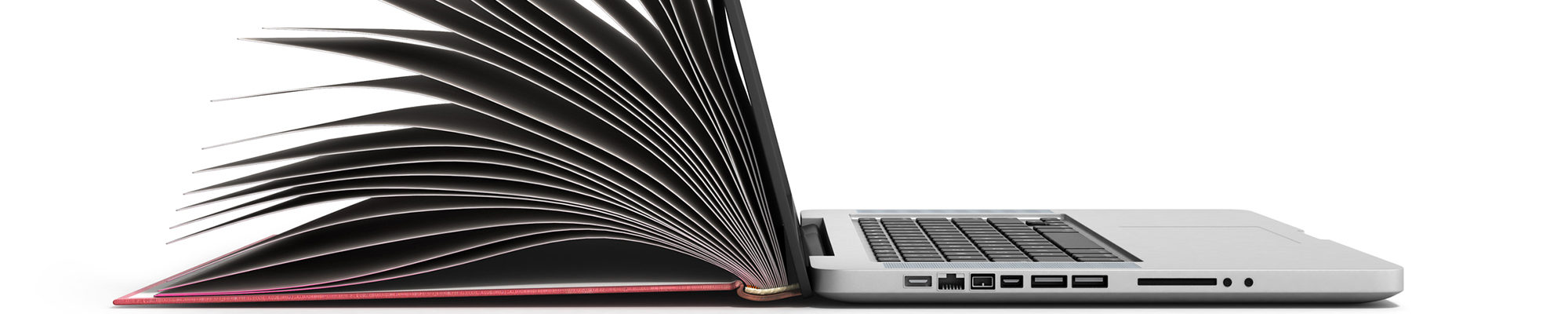 A photo of a book transitioning to laptop