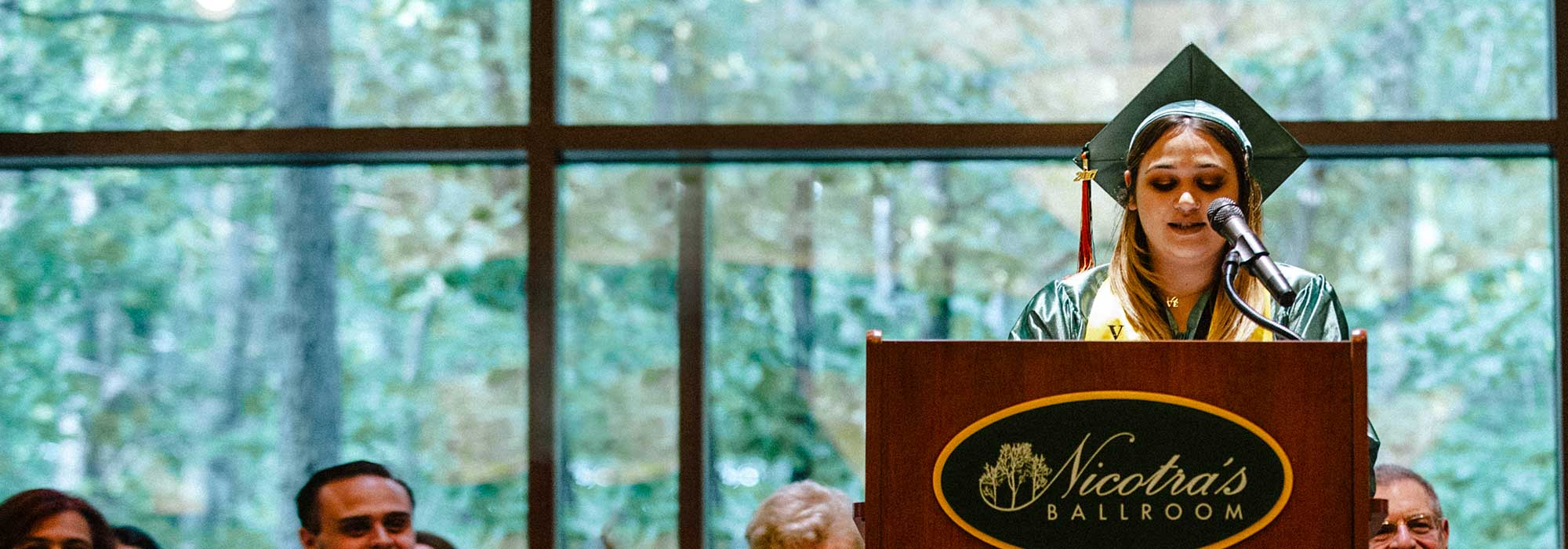 A student giving a speech on the podium
