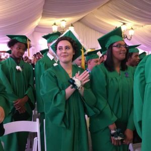 New Ventures students standing at graduation